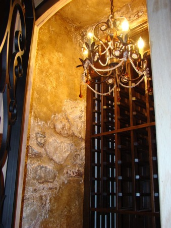 wine cellar under the stairs, Turn an un-used closet under the stairs into a wonderful focal point!! Put in some wine cabinets... trade your can light for a chandelier, put on an fancy door... now all you need is some rustic walls. , Dining Rooms Design