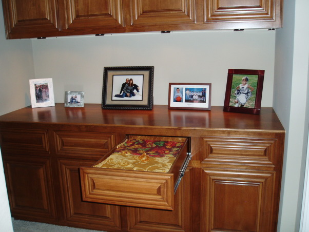 Hall cabinet, Hallway linen cabinet, My husband built the cabinets to fit the space which utilized every inch. This allowed for extra deep drawers and cabinets.  We were also able to stain the Alderwood the exact color we wanted.  The lighting under the top cabinet makes it a real showplace. , Other Spaces Design