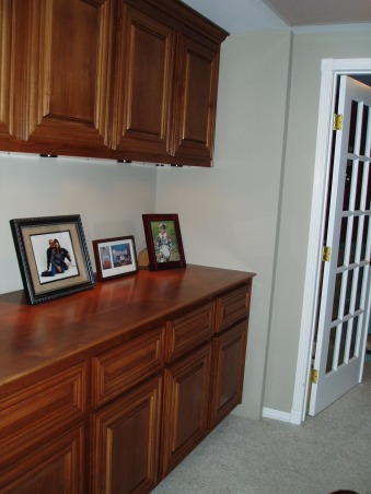 Hall cabinet, Hallway linen cabinet, The cabinets opened up the narrow and stark hallway as well as providing a place to display photos and a tremendous amount of storage space for linens and nic-nacs. , Other Spaces Design