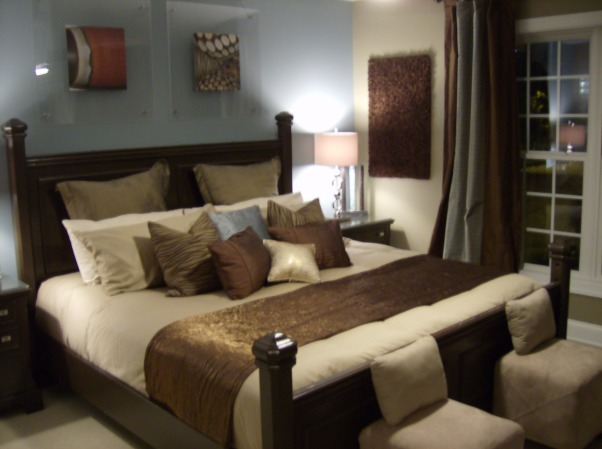 Guest Retreat, This Guest Bedroom is a plush retreat that is filled with exciting surprises. This plush retreat features chocolate furniture accompanied with brushed nickel fixtures. Neutral bed linens with accent colors of blue and chocolate with blue and chocolate silk window treatments that puddle to the floor. In addition, this room also features personalized abstract art work on the walls, brushed nickle lamps with a contemporary flare, creative nightstand art, and uplighting with a twist., King bed featuring neutral bed linens with accent colors of blue and chocolate. Design pillows for extra pop!, Bedrooms Design