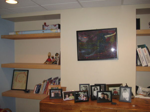 Ugly Basement, We have greeat space, but it needs to be updated to a fun and cozy entertainment lounge. It has a small bar area, as well as several closets and a bathroom. The space has no heat so it is often very chilly down there. What would be the best way to upgrade this space? We use it for exercising and watching TV., Bookshelf in the right side of the basement , Basements Design