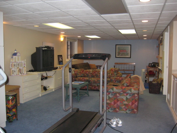Ugly Basement, We have greeat space, but it needs to be updated to a fun and cozy entertainment lounge. It has a small bar area, as well as several closets and a bathroom. The space has no heat so it is often very chilly down there. What would be the best way to upgrade this space? We use it for exercising and watching TV., Full view of the lower level , Basements Design