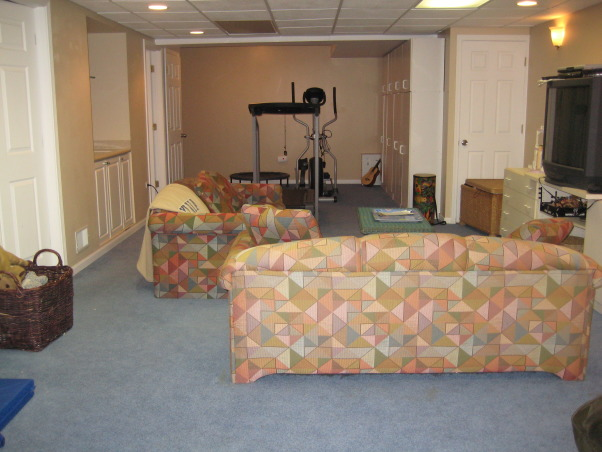 Ugly Basement, We have greeat space, but it needs to be updated to a fun and cozy entertainment lounge. It has a small bar area, as well as several closets and a bathroom. The space has no heat so it is often very chilly down there. What would be the best way to upgrade this space? We use it for exercising and watching TV., Backwards view of the lower level , Basements Design