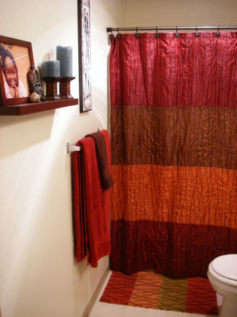 African themed bathroom, Apartment bathroom, so walls are not to be painted. I traveled to Kenya and wanted to bring some kenya culture to my home. , I got the shower curtain and towels at Bed Bath and Beyond. Some stuff from Goodwill and the rest from Target. Very cheap stuff that go together. , Bathrooms Design