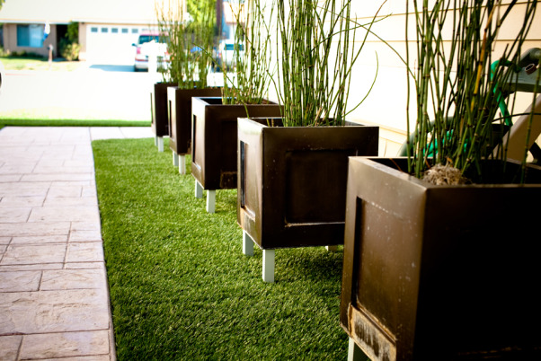 Artifical Lawn, 700 sq. ft. of artifical lawn. Five bronze planters elevated on legs with Horsetails planted inside.  Stamped concrete walkway., After, Landscaping