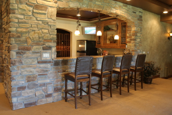 Mountain Rustic Media, This is in a parade home I did with a Colorado Rustic Mountain theme.  The media room is an open concept with the Recreation room open to the theatre.  The bar area is enclosed with stone and the wine cellar is located off the inside of the bar., Outside of the bar area. , Media Rooms Design