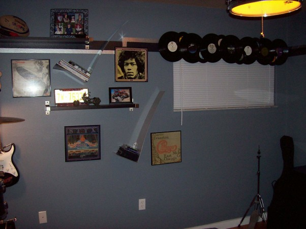 Rock N' Roll Bedroom, As a Christmas present to my 15 year old son, I redecorated his room while he was out of town for a week.  The theme of the room is Classic Rock N' Roll.  Included in the room are drums, Guitars and a airbrushed mural of an album cover. , More wall decorations, Boys' Rooms Design