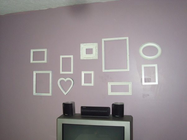 Ikea Brown/Purple Retro Living Room, Thought I would share this inexpensive wall art idea.  I bought all different sized and shape frames at a thrift store and painted them all cream color.  Cost about $7 total! , Living Rooms Design