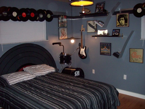 Rock N' Roll Bedroom, As a Christmas present to my 15 year old son, I redecorated his room while he was out of town for a week.  The theme of the room is Classic Rock N' Roll.  Included in the room are drums, Guitars and a airbrushed mural of an album cover. , Wall decorations including framed album covers., Boys' Rooms Design