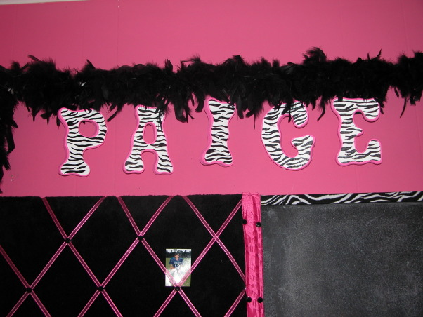 HOT Pink With Zebra Print , My 11 year old daughters new room. I am not a professional sewer or painter but I like to try.. I love to re use stuff we already have, so I re painted my daughter name, it was so much easier than I thought it would be. I also painted her pencil holder. I recovered her picture and chalkboard, mirror and trash can. I am new to all this sewing stuff so I really think the window covers turned out really good for me.... her room was already hot pink so I made long black drapes to brake up the pinks. I used hot pink and zebra to make the middle. To make sure the zebra panels came out even i made it as one then cut it in half... My daughter had a full size poster bed, but she wanted a futon bed whichwe found at Walmart for 129.00. I found the bedding online it is so soft and came with through pillows we just love it  I found a hot pink zebra clock, phone cover, switch cover and a zebra lap top skin on ebay....  My daughter new we were re doing her room for Christmas, but she had no idea what it was going to look like until Christmas.... we kicked her out of her room for two days so we could put it all together... she was so excited.....now she had her new pre teen room   , I used ribbon on the back of the letters so I could hang them on the wooded rod.   I put tacks in the back of the wooded rod... it was kind of hard to get the tacks in the wood but well worth the stress., Girls' Rooms Design