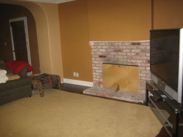 Family/Game Room, Large open space that has a small area for a family room which leads into a game room, The family room area showing the fireplace..it actually works, but it is covered so the cold air won't get inside , Living Rooms Design
