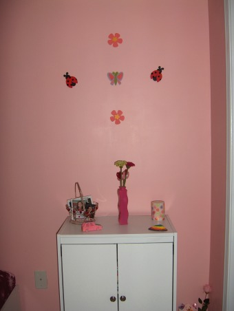 8 year old simple bedroom, We painted my daughter's room last year for her birthday the color she wanted. I still need couple frames but I'l take my time until I find the right ones., These are cute butterfly and flowers.  , Girls' Rooms Design