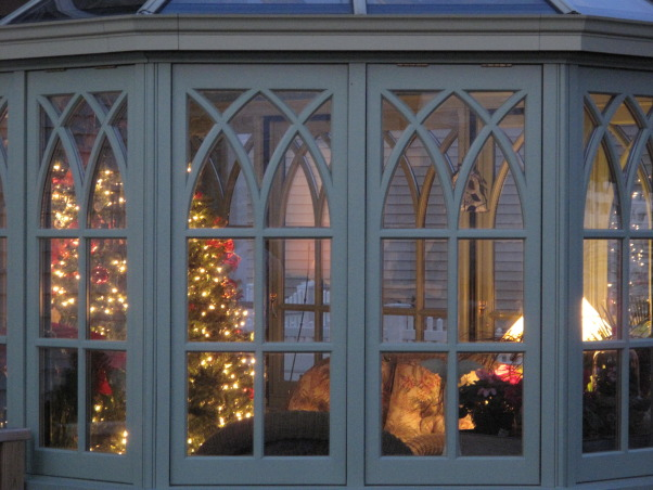 The Conservatory, This old English style glass room, or conservatory was a two year project from start to finish.  The room was manufactured in Ireland, and is constructed from mahogany.  The room is situated off the back of my living room where you enter through French doors.  I love the cathedral style windows, and the slate floor.  A perfect room to sit and read or do some early gardening during the winter.  Follow my blog MeadowsweetDays.blogspot.com   , A view of the cathedral style windows  , Other Spaces Design