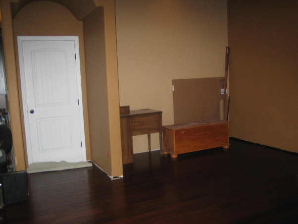 Family/Game Room, Large open space that has a small area for a family room which leads into a game room, Nook in the game room that we hope to make a video game area, Living Rooms Design