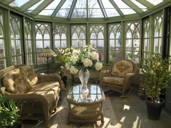 The Conservatory, This old English style glass room, or conservatory was a two year project from start to finish.  The room was manufactured in Ireland, and is constructed from mahogany.  The room is situated off the back of my living room where you enter through French doors.  I love the cathedral style windows, and the slate floor.  A perfect room to sit and read or do some early gardening during the winter.  Follow my blog MeadowsweetDays.blogspot.com   , This old English style Conservatory was a two year project from start to finish, but it was definitely worth the wait.  We enjoy this room in every season, but particularly on a cold winter day.  The sun pours in and no matter how cold  it may be outside it is always sunny and beautiful inside.  A great place to get seeds started in the spring.  , Other Spaces Design