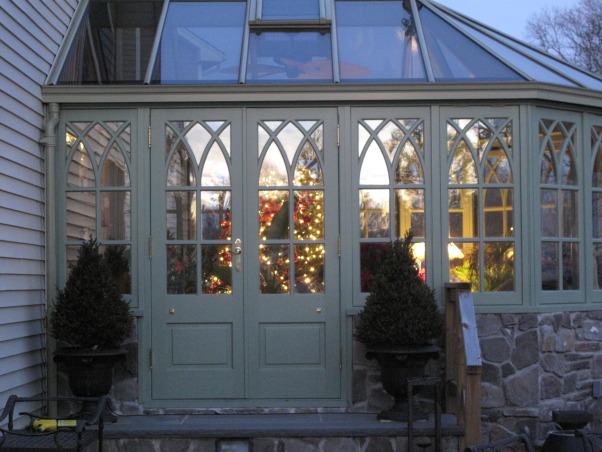 The Conservatory, This old English style glass room, or conservatory was a two year project from start to finish.  The room was manufactured in Ireland, and is constructed from mahogany.  The room is situated off the back of my living room where you enter through French doors.  I love the cathedral style windows, and the slate floor.  A perfect room to sit and read or do some early gardening during the winter.  Follow my blog MeadowsweetDays.blogspot.com   , Outside view of the double doors.  , Other Spaces Design