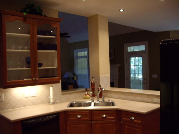 Neely Kitchen, Wood cabinets, wood floors, black appliances, halogen lighting, Looking out towards family room, Kitchens Design