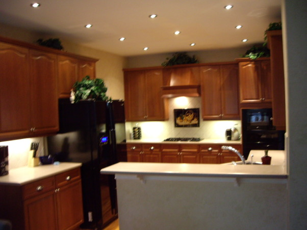 Neely Kitchen, Wood cabinets, wood floors, black appliances, halogen lighting, Kitchens Design