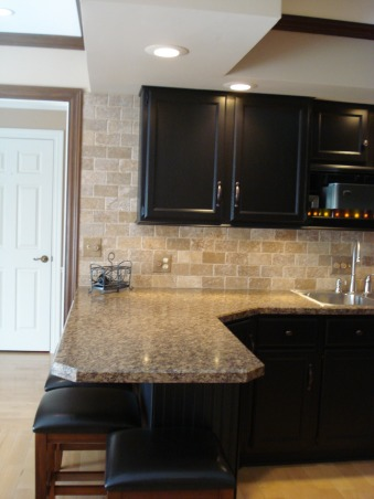 22 year old kitchen update, Updated kitchen by painting cabinets, adding wainscoting, crown and lower cabinet moldings, new laminate counter top and stainless appliances along with tumbled marble backsplash., Under cabinet lighting and molding on the bottom of cabinets, Kitchens Design