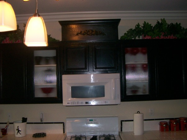 Repost- Red, White and Black Kitchen Reno for under $1,000.00 - Cabinet Top Added, A few months ago we painted my cabinets black,  put in a new sink, added lighting and did a few other things to update my kitchen.  I spotted the space by alettasdesign called Painted and Glazed Cabinets and followed her directions on adding a top to my center cabinet.  , Center cabinet with three sided box added    , Kitchens Design