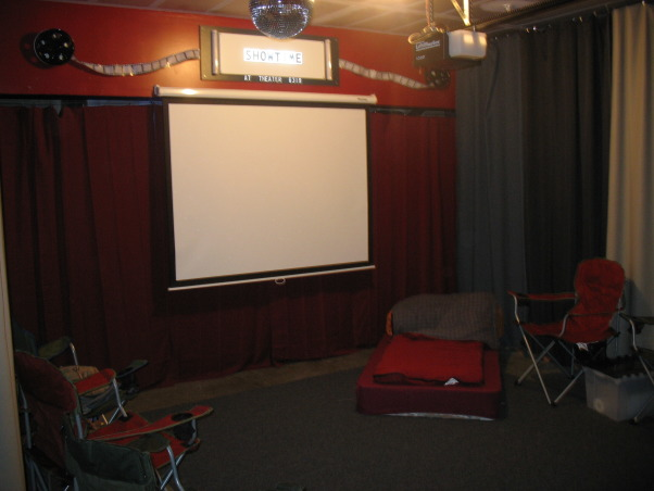 "Garage Turned Party Room, I turned my garage into a movie theater/party room for my two boys., 40"" movie screen, full length curtains, projector, snak bar, hotdog machine, popcorn machine, microwave, fridge, music, disco ball, surround sound...we're ready to party! , Garages Design"