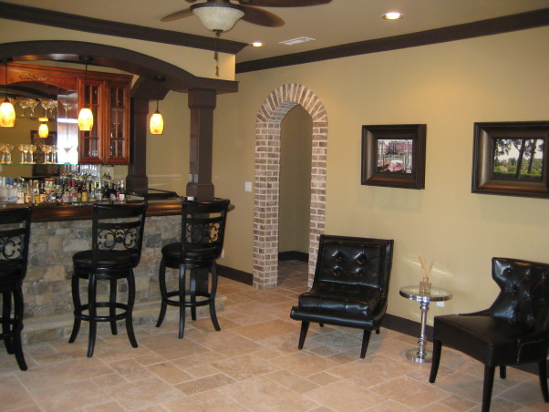 Tuscan Basement , My husband & I completely designed our basement. We told and drew pictures for our contractor on what we wanted. Our basement was nothing but 2x4's and windows since we had the house built. We wanted it to have an old world Tuscan feel with a little more luxury. We live on a lake in subdivision and it's about time we took advantage of the space and windows that overlook the lake. All the stacked stone is real, natural travertine, and real brick from Boral. It was a 3mo. labor of love coordinating,researching, and picking everything out. We still have some more decorating to do(theater room,workout area) but all in all we are very pleased how it has turned out. Every item we purchased was either clearance or on sale. We got a deal on everything we purchased for the basement. , bar room and sitting area         , Basements Design