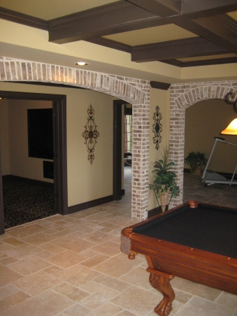 Tuscan Basement , My husband & I completely designed our basement. We told and drew pictures for our contractor on what we wanted. Our basement was nothing but 2x4's and windows since we had the house built. We wanted it to have an old world Tuscan feel with a little more luxury. We live on a lake in subdivision and it's about time we took advantage of the space and windows that overlook the lake. All the stacked stone is real, natural travertine, and real brick from Boral. It was a 3mo. labor of love coordinating,researching, and picking everything out. We still have some more decorating to do(theater room,workout area) but all in all we are very pleased how it has turned out. Every item we purchased was either clearance or on sale. We got a deal on everything we purchased for the basement. , Arches in pool room, hall        , Basements Design