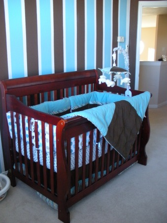 Modern turquoise and chocolate baby boy nursery, A modern, bright nursery for our baby boy, due in January 2009.  Polka dots and stripes are featured to stimulate baby's little brain.  Turquoise and brown are the main colors.  The bedding is Luke, ordered from J.C. Penny.  The crib and changing table are Simplicity's Ellis collection, which has since been discontinued.  The glider is by best chairs.  , Nurseries Design