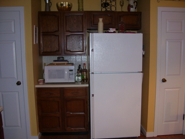 """Our hodge-podge kitchen, I love the space in our kitchen and the fact that it is an eat-in.  However, I would love to have some suggestions on what to do with our cabinets, counters, and layout.  Our countertops are laminate and they are """"bubbling"""" up in several spaces.  I love the space of our cabinets but am not fond of the color/doors.  We bought our home after it had been mistreated for years.  We've updated every room but the kitchen and bathroom.  I would describe our style as simple, classic, traditional.  We are not into modern and sleek.  , This nook is between two small pantries.    , Kitchens Design"""