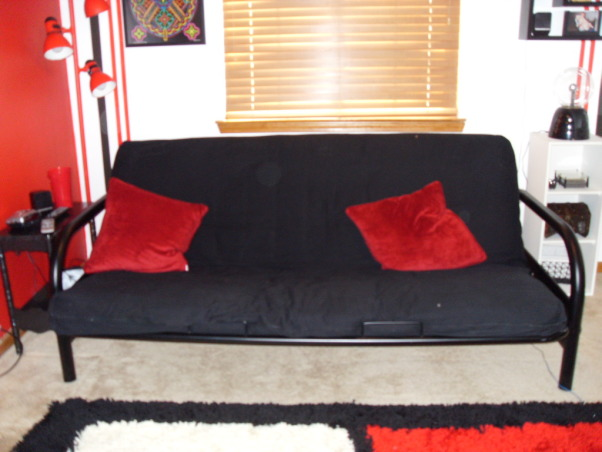 Pre-teen modern bedroom, Modern color splash boys space that will last for years., Futon enhances black and red color focus., Boys' Rooms Design
