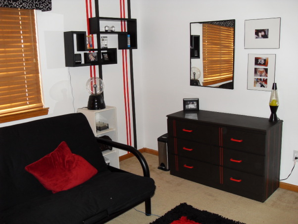 Pre-teen modern bedroom, Modern color splash boys space that will last for years., Three walls painted white to make room feel larger,Stripes hand painted on walls in varying thickness. Same dresser painted black, red handles added as well as red car outstripping., Boys' Rooms Design