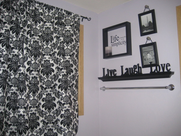 "purple and black and white, It is the master bath and as apprehensive as my husband was about a purple bathroom he thinks that it turned out ""okay."" I actually really love this bathroom and mostly got everything at yard sales, made the curtains myself, and my brother drew the large picture over the tub., I looked for a long time for curatins, I could see what I wanted in my head, but they were all very expensive, so I came upon material and whipped em up. (Don't look too close at the craftsmanship!) I haven't changed the pictures in the frames yet because I didn't want to put people I knew in them because it over looks the tub and I thought it was creepy, any suggestions?  , Bathrooms Design"