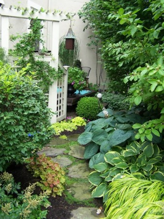 Side garden, This is the small space between close set suburban houses. It has a narrow stepping stone path and flowers and trees on both sides. As close as we are it feels very private., About midway through the journey is the air conditioning unit which I hid with the trellis., Gardens Design