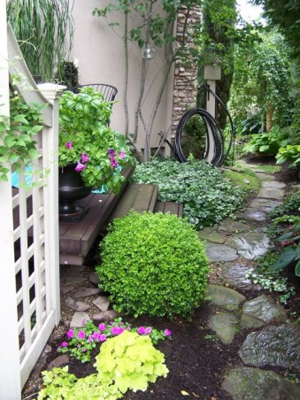A small space side yard garden, This stepping stone path takes you from the driveway, down the side yard, to back gardens. It's only 4 or 5 feet wide at it's narrowest and about 9 feet wide at the widest. , Approaching the exit to the back yard., Gardens Design