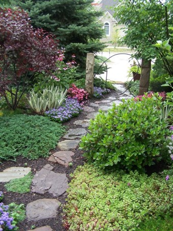Side garden, This is the small space between close set suburban houses. It has a narrow stepping stone path and flowers and trees on both sides. As close as we are it feels very private., This is exiting the garden onto our driveway. I added the vertical stones to create more of a threshold feeling when you enter., Gardens Design