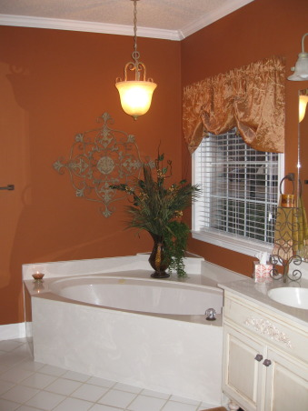 Burnt Orange Master Bath, Tub area - was able to use left over fabric from bedroom to make a topper for window.  Added some beads to treatment.   , Bathrooms Design