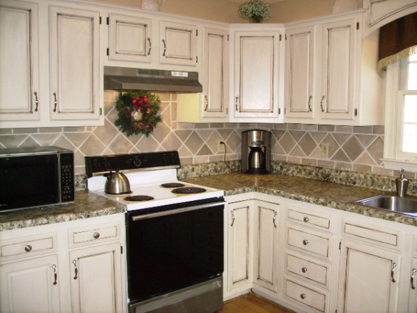 My $17.00 kitchen makeover, We are renting right now and this kitchen was GROSS!  I couldn't live with it.  The dark cabinets and the green laminate counter tops had to go!  If I had money (and owned the house)  I would have done things differently....like granite,  new appliances etc.  But I did what I could to make it look better and it is all done with paint.  Total project cost:  $17.00., Kitchens Design