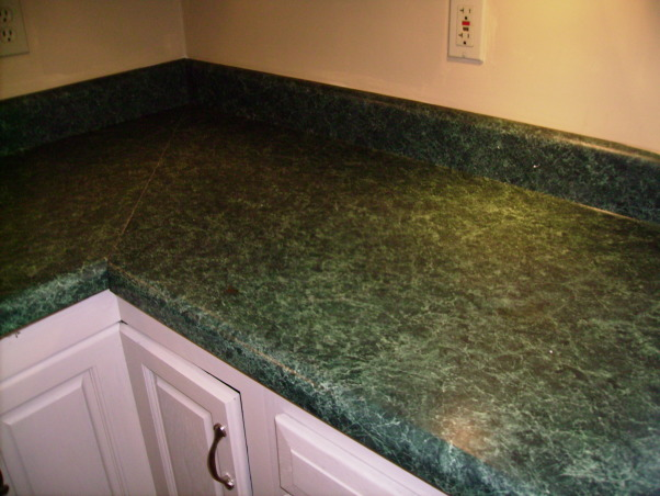 My $17.00 kitchen makeover, We are renting right now and this kitchen was GROSS!  I couldn't live with it.  The dark cabinets and the green laminate counter tops had to go!  If I had money (and owned the house)  I would have done things differently....like granite,  new appliances etc.  But I did what I could to make it look better and it is all done with paint.  Total project cost:  $17.00., Counter top before        , Kitchens Design