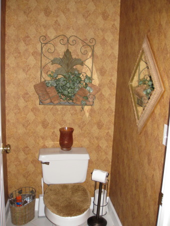 Burnt Orange Master Bath, This is the water closet.  Papered this area to coordinate with master bedroom and bath.   , Bathrooms Design