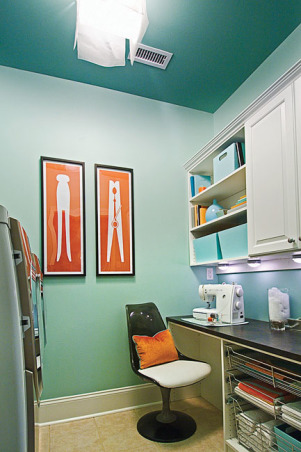 Laundry Room and Craft Space, I wanted to create a functional space for laundry as well as folding clothes, sewing, and other crafts.  Because there are no windows in the space, I used light and bright colors.  The accessories add a touch of whimsy and make it a space you actually want to spend time in., The retro chair was purchased on eBay and reupholstered in a white faux ostrich fabric. , Other Spaces Design