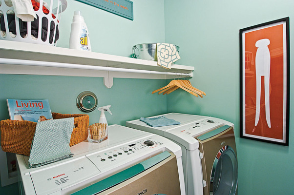 "Laundry Room and Craft Space, I wanted to create a functional space for laundry as well as folding clothes, sewing, and other crafts.  Because there are no windows in the space, I used light and bright colors.  The accessories add a touch of whimsy and make it a space you actually want to spend time in., The embroidered fabric says, ""It all comes out in the wash."" , Other Spaces Design"
