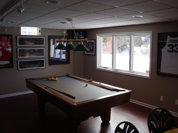 My newly finished basement sports bar, This space was finished in an unfinished lower level walkout basement.  The key was to keep a wide open space, yet make it cozy and warm feeling., Pool room mixes classic Detroit sports memorabilia and TV with old pool table.       , Basements Design
