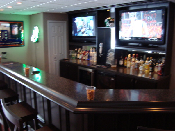 My newly finished basement sports bar, This space was finished in an unfinished lower level walkout basement.  The key was to keep a wide open space, yet make it cozy and warm feeling., The bar took two LCD's that I got at Walmart on Black Friday for nearly the price of one and added a kegarator and glass fridge from Home Depot.  It came out better than expected.    , Basements Design