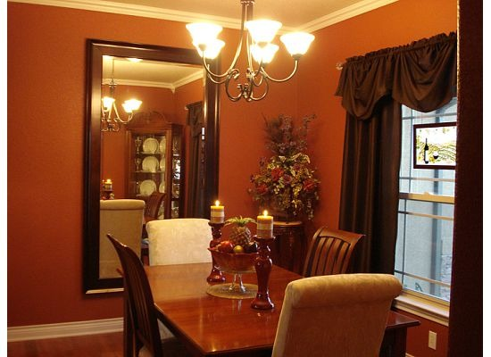 Bold colors in the dining room, Here is a very light dining room with bold colors added., Crown molding details the room and the mirror helps to make it larger., Dining Rooms Design