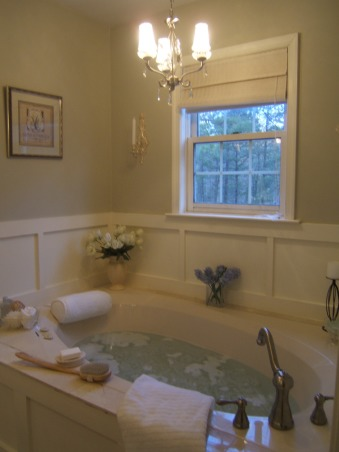 From hideous to spa-tacular!, This was my master bath in one of the houses I flipped.  Before the walls were peach with dark wood trim and hunter green tile with linoleum floor.  Everything was redone from the chandeliers to the marble floor for under 1,000., Bathrooms