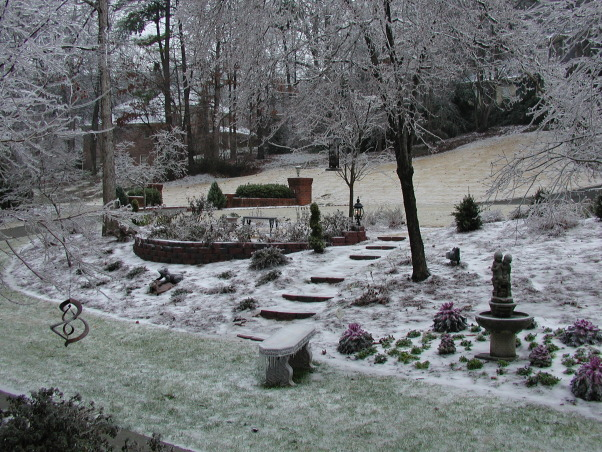 French Chateau Style in Georgia, Dogwoods in the Spring and a Winter's sprinkling of snow, Front garden dusted with snow      , Home Exterior Design