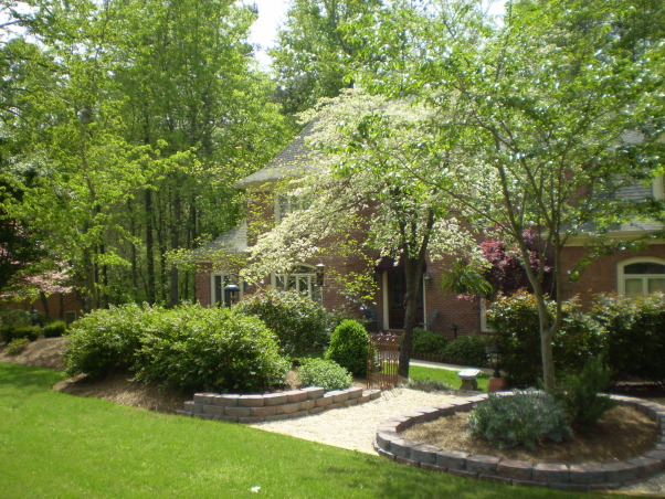 French Chateau Style in Georgia, Dogwoods in the Spring and a Winter's sprinkling of snow, White dogwood blooms in courtyard entry      , Home Exterior Design