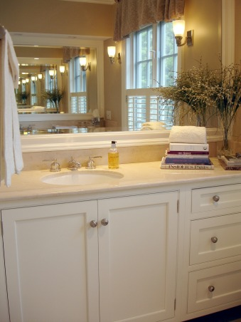 "A Masterful Master , This is a master bath that was created for clients to have a place for a quiet respite.  The understated space is crisp, clean, and calm. The double vanities with the sinks offset allow both to use the space without ""being"" in the way., This image allows you to see the ""infinity"" that is created by having mirrors on opposing walls. A great way to expand a space. The limestone counters tie in to the floor tile and the mosaic trim in the bath and shower area.   , Bathrooms Design"
