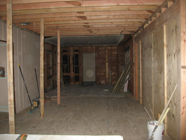 Family Room, BEFORE The family room was created from the original den and adjoining sun room.  Two walls were taken down to open up the space., Kitchens