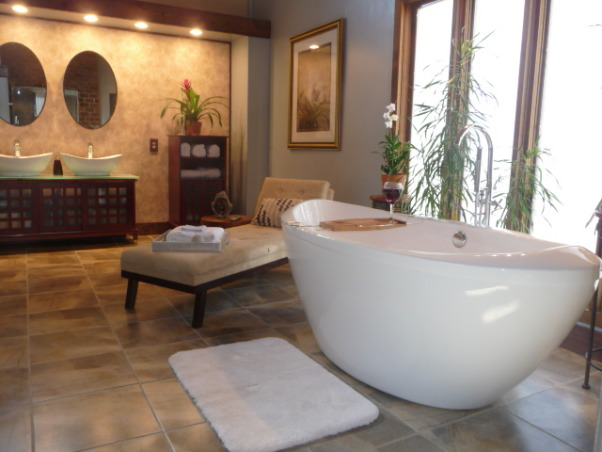 DIY Asian Inspired Spa Bathroom, We converted our 70's bathroom to an Asian inspired, comfortable place to relax.  Features a slipper soaking tub, a steam shower and a flat screen to watch HGTV.  No contractors, designers, or other professionals were used in the making of this remodel!    We have had so many comments about our tub, I wanted to share the link where we purchased it: http://www.bathtubsfactorydirect.com  Vanity was purchased from Costco, as was the additional storage unit.  Paint is Autumn Fog Valspar from Lowes. , Remodeled bathroom is 240 square feet.  The soaking tub sits in front of large opaque windows for plenty of natural light.  16x16 porcelain tiles were used throughout.            , Bathrooms
